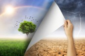 Change concept, Woman hand turning arid and rain with lightning storm environment paper page to good environment.