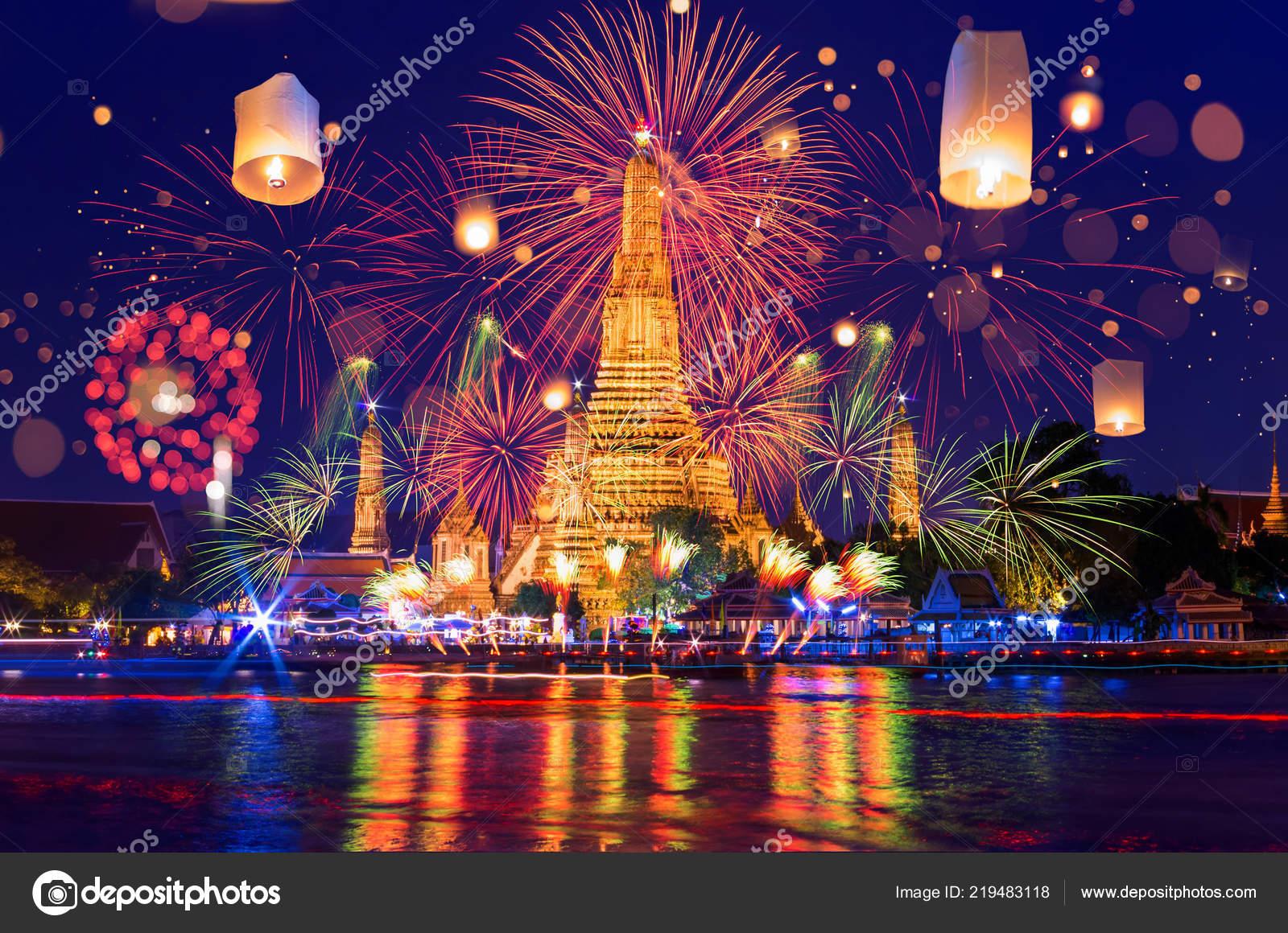 bangkok happy new year countdown fireworks and lanterns at wat arun temple bangkok thailand photo by nirutdps
