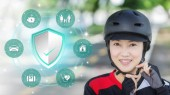 Photo Asian women wearing helmet, Insurance policy services conceptual design. insurance shield, Family Homes, Finance, Cars, Travel and Health Insurance.