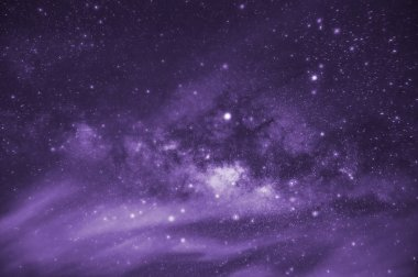 Ultra violet tone, Milky way galaxy with stars and space dust in the universe, long speed exposure, Tone purple trend.
