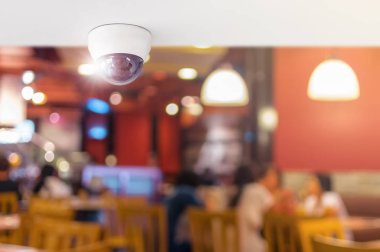 CCTV system security inside of restaurant, Surveillance camera installed on ceiling to monitor for protection customer in restaurant, Concept of surveillance and monitoring.