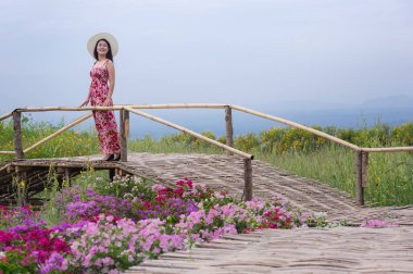 Beautiful woman in nature in Tung Bua Tong Mexican field in Mae Moh Coal Mine, Lampang Province, Thailand.