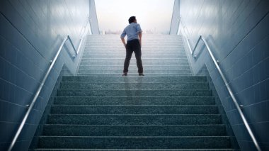 Businessman climbed on top of the stairs going to the city,  Ambitions concept and Success business.