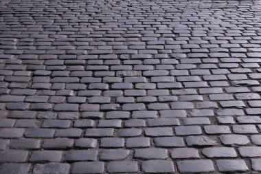 Old stone pavement on the city streets, Kazimierz district in Krakow Poland ...