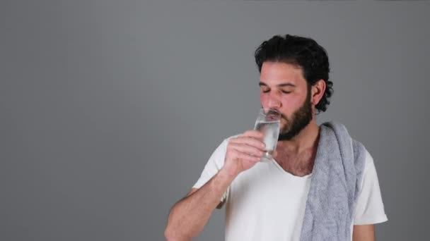 Portrait of young handsome man drinking water