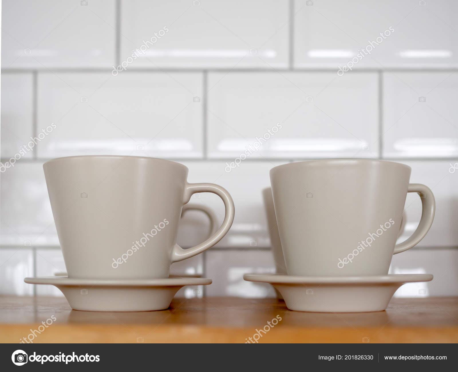 2729c73277c Row White Ceramic Coffee Mugs Wooden Shelves White Brick Wall — Stock Photo