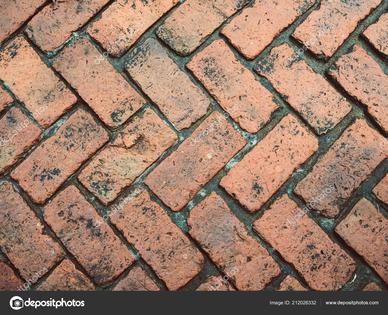 Fußboden Aus Ziegelsteinen ~ Alte orange ziegel gefliesten boden mit zickzackmuster textur