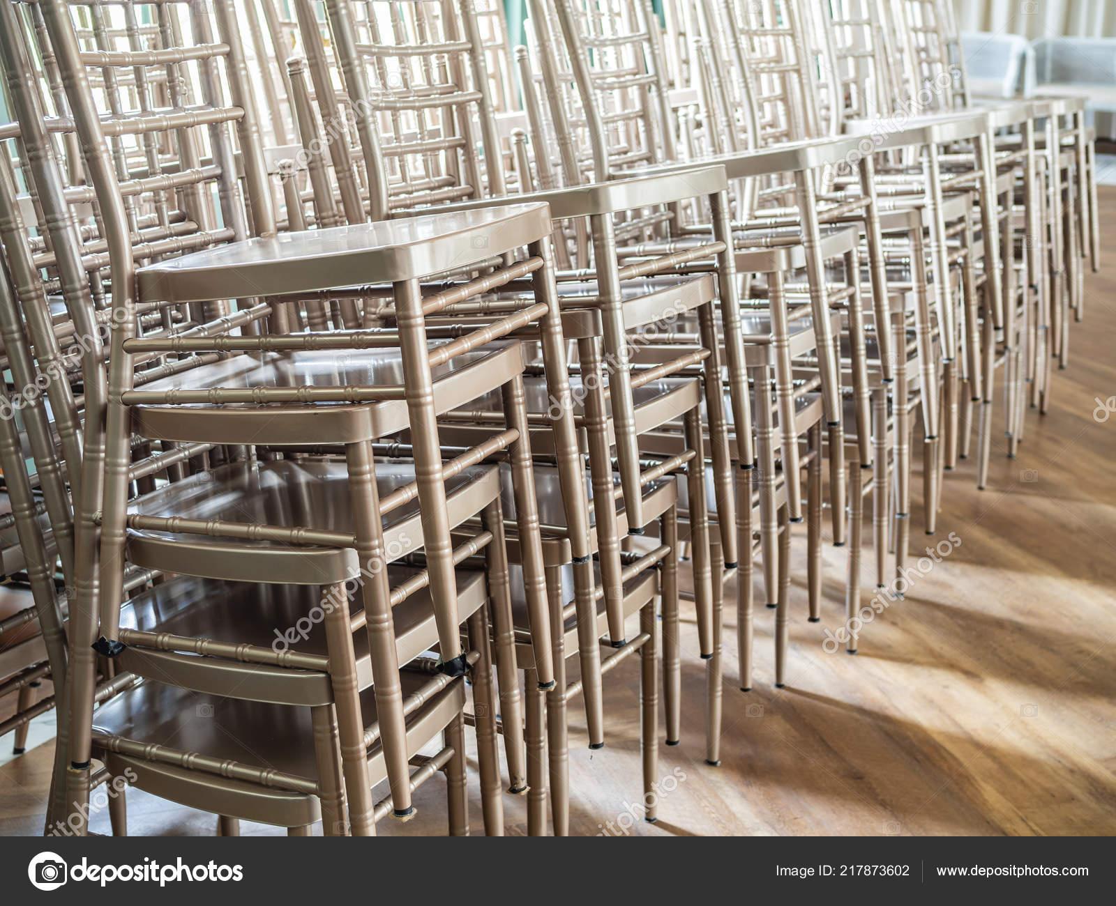 Stupendous Rows Modern Stacked Silver Chairs Wooden Floor Light Window Machost Co Dining Chair Design Ideas Machostcouk