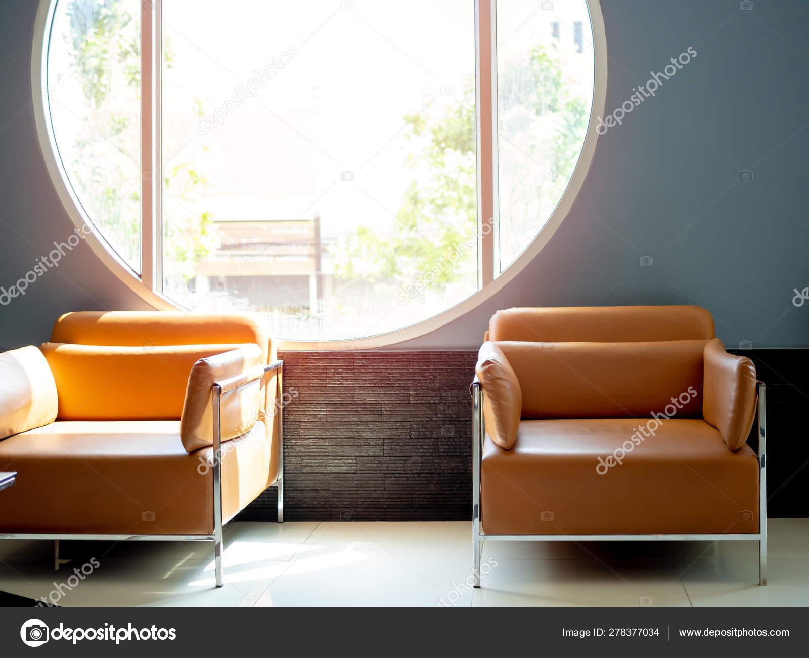 Fabulous Modern Orange Leather Sofa On Blue Background With Round Machost Co Dining Chair Design Ideas Machostcouk