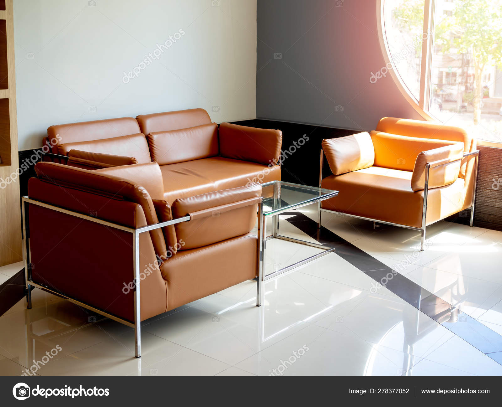 - Modern Orange Leather Sofa Set With Glass Table On Blue Backgrou