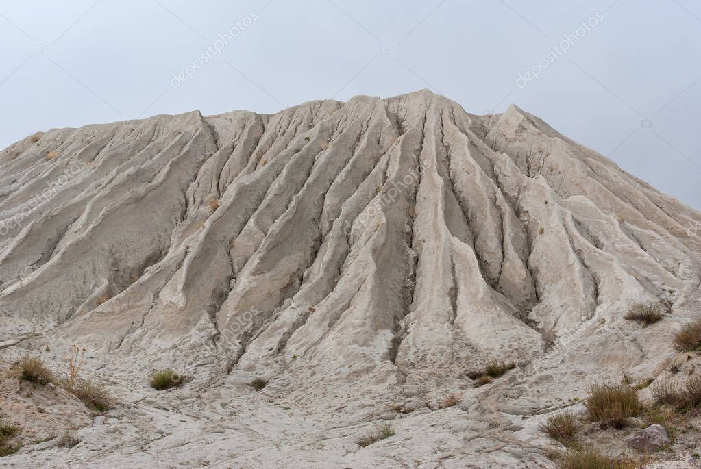 Mountain made from macadam and sand in open-pit mining for rock