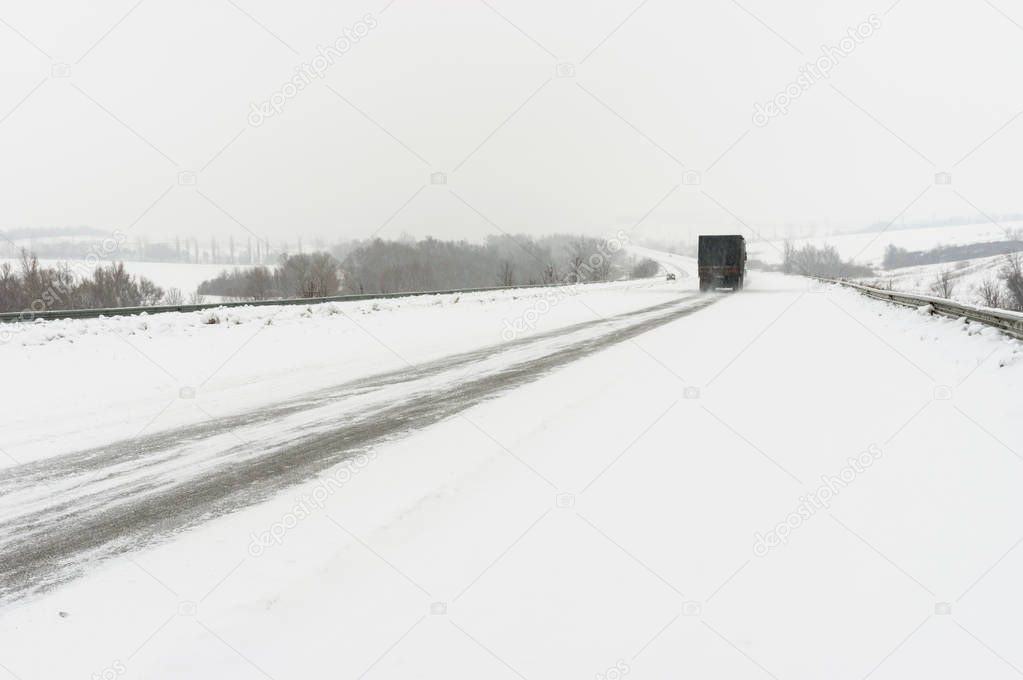 Winter landscape with highway and snow-drift near Dnepropetrovsk city, Ukraine