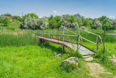 Iron footbridge over small Ukrainian river Sura