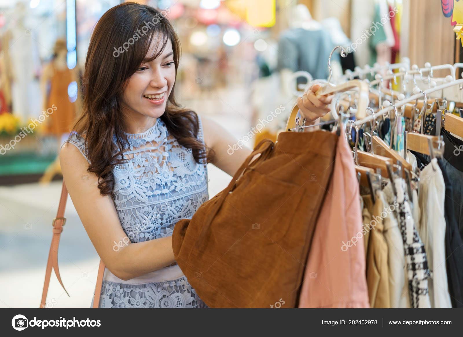 651e09fc1bd30 Young Woman Shopping Clothing Store — Stock Photo © geargodz #202402978