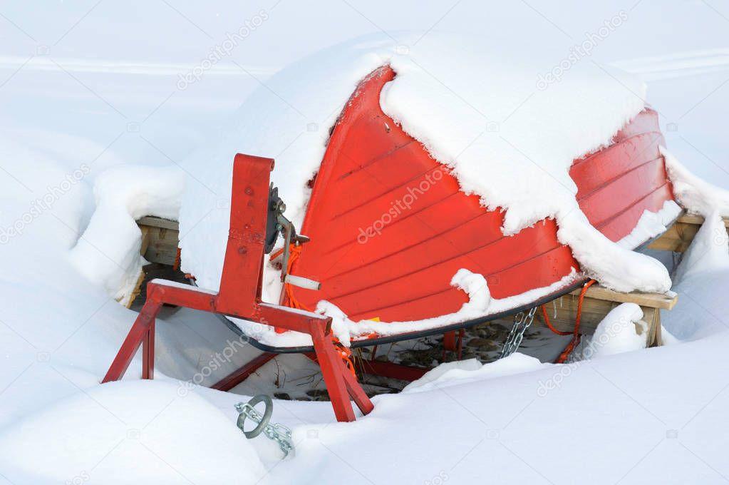 Boat upside down in snow