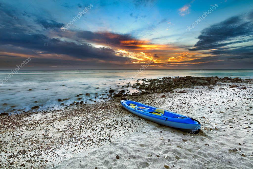 Canoe Kayak on beach during sunset, Saint-Leu, reunion island
