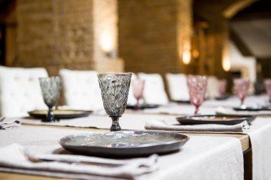 Empty glasses set in restaurant. Banquet table set