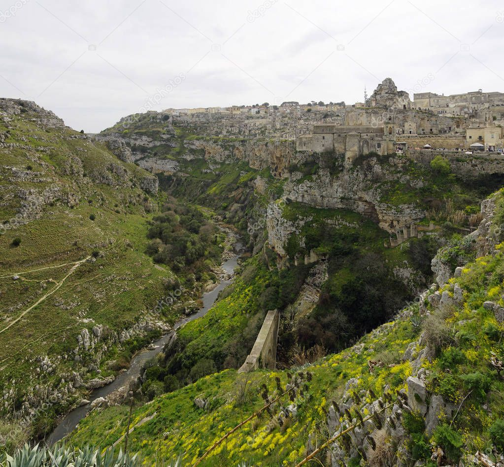 A landscape of Matera river and cityscape of The Sassi of Matera which constitute the historic center of the Matera