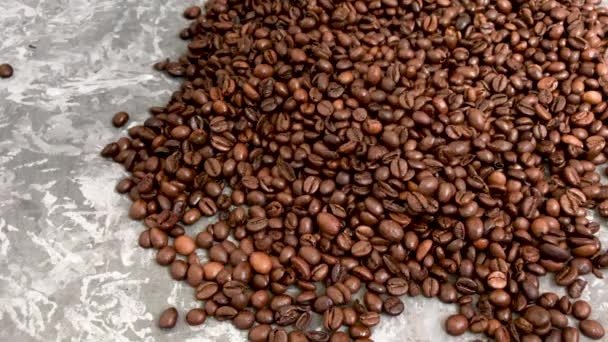 Falling roasted coffee beans on grey background
