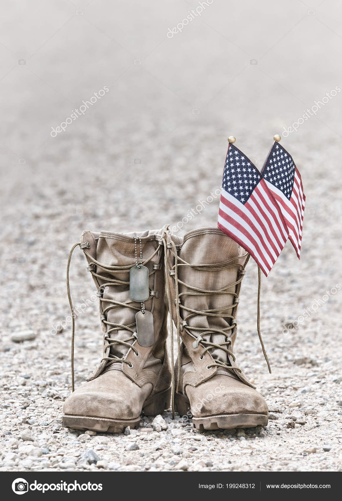 798738bf2ec0 Old military combat boots with dog tags and two small American flags. Rocky  gravel background with copy space. Memorial Day or Veterans day concept.