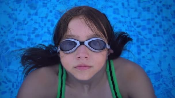 Child is Swimming in Swimming Pool
