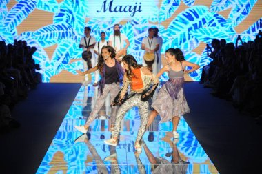 MIAMI BEACH, FL - JULY 15: Dance performance on the runway for Maaji during the Paraiso Fasion Fair at The Paraiso Tent on July 15, 2018 in Miami Beach, Florida.