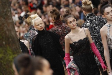 PARIS, FRANCE - MARCH 06: Models walk the runway finale during the Chanel show as part of the Paris Fashion Week Womenswear Fall/Winter 2018/2019 on March 6, 2018 in Paris, France.