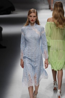 MILAN, ITALY - SEPTEMBER 23: A model walks the runway at the Blumarine show during Milan Fashion Week Spring/Summer 2018 on September 23, 2017 in Milan, Italy.