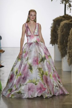 NEW YORK, NY - SEPTEMBER 08: A model walks the runways at Badgley Mischka - Runway during New York Fashion Week: The Shows at Gallery I at Spring Studios on September 8, 2018 in New York City.