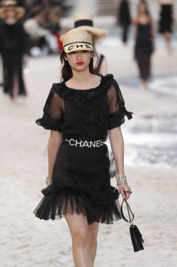PARIS, FRANCE - OCTOBER 02: A model walks the runway during the Chanel show as part of the Paris Fashion Week Womenswear Spring/Summer 2019 on October 2, 2018 in Paris, France.