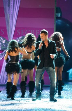NEW YORK, NY - NOVEMBER 09: Singer Ricky Martinin performs live on stage at the 2005 Victoria's Secret Fashion Show on November 09, 2005 in New York City.