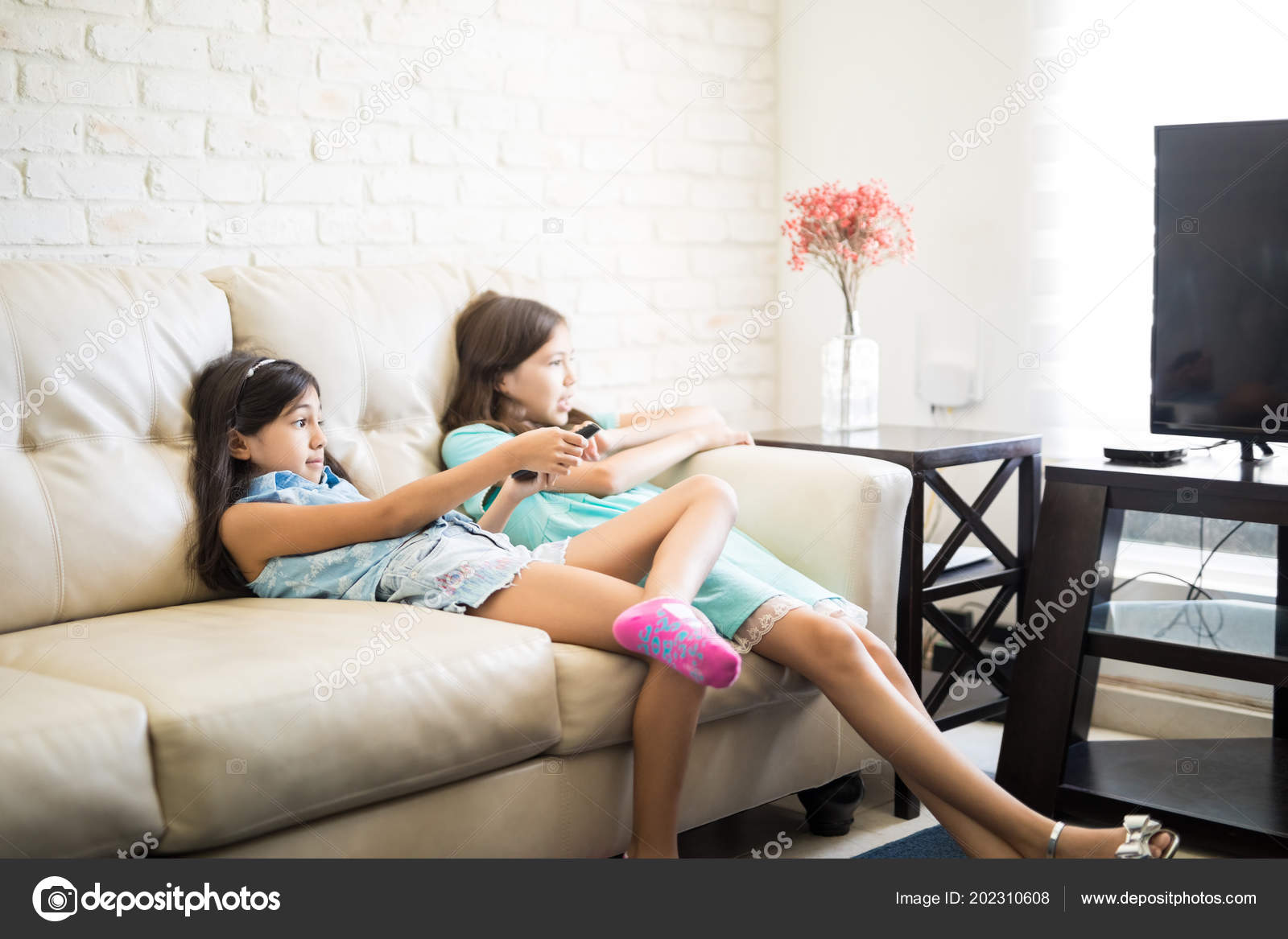 Remarkable Small Girl Selecting Channel Remote While Sitting Couch Home Alphanode Cool Chair Designs And Ideas Alphanodeonline