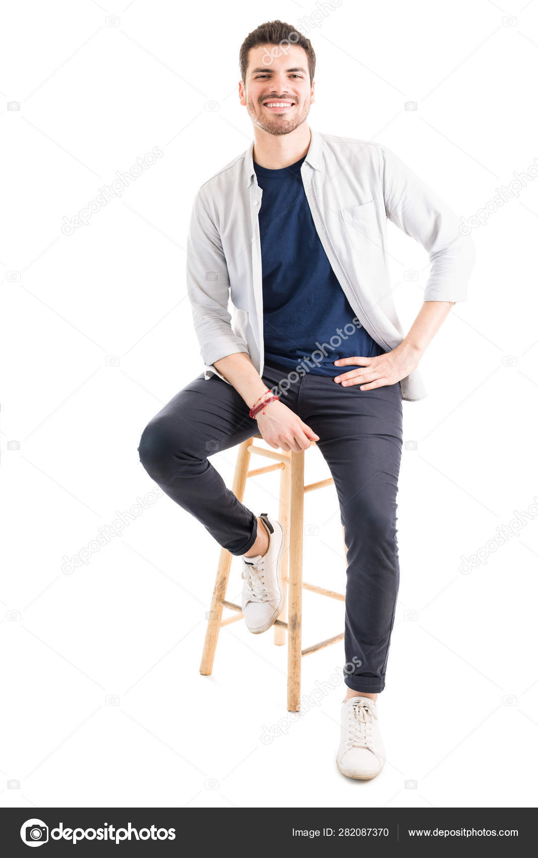 Amazing Attractive Man Casual Sitting Wooden Stool While Smiling Ocoug Best Dining Table And Chair Ideas Images Ocougorg
