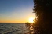 Fotografie Einen wunderschönen Sonnenuntergang am See Chiemsee Chiemsee, Bayern, Deutschland