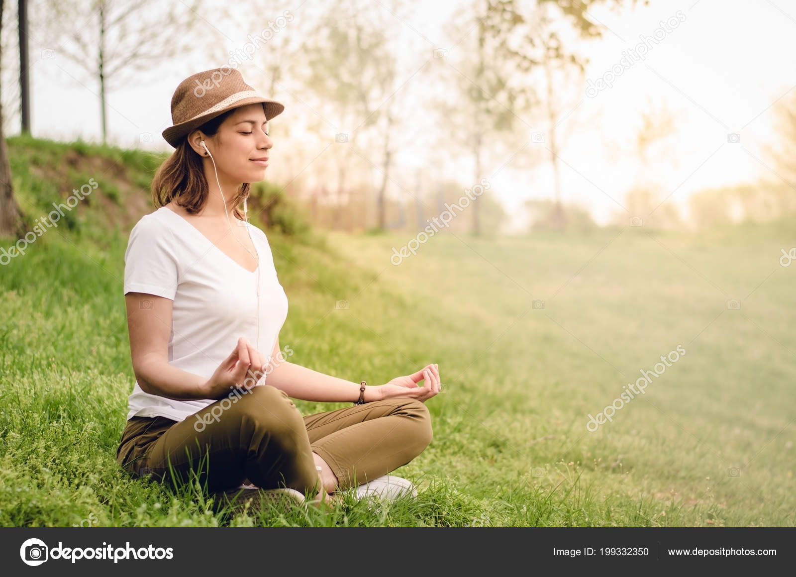 Young Beautiful Woman Meditating Nature Morning While Listening Music Sunrise Stock Photo C Eshana Blue 199332350