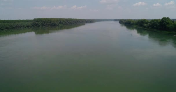 Wide river. Flying along. Drone shot.