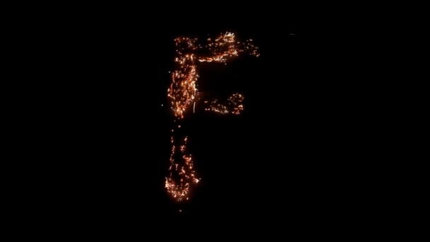 Letter F burning. Steel wool smoldering. Beautiful combustion.