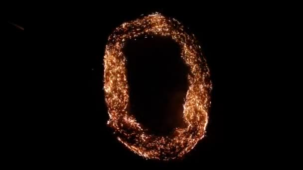 Letter O burning. Steel wool smoldering. Beautiful combustion.
