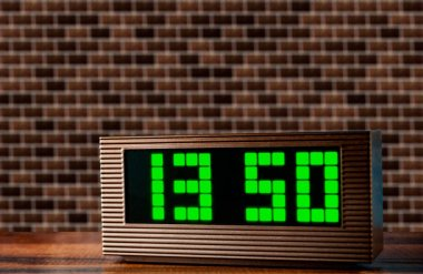electronic clock on the surface on a brick wall texture background
