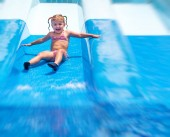 little daughter having fun in Aqua park.
