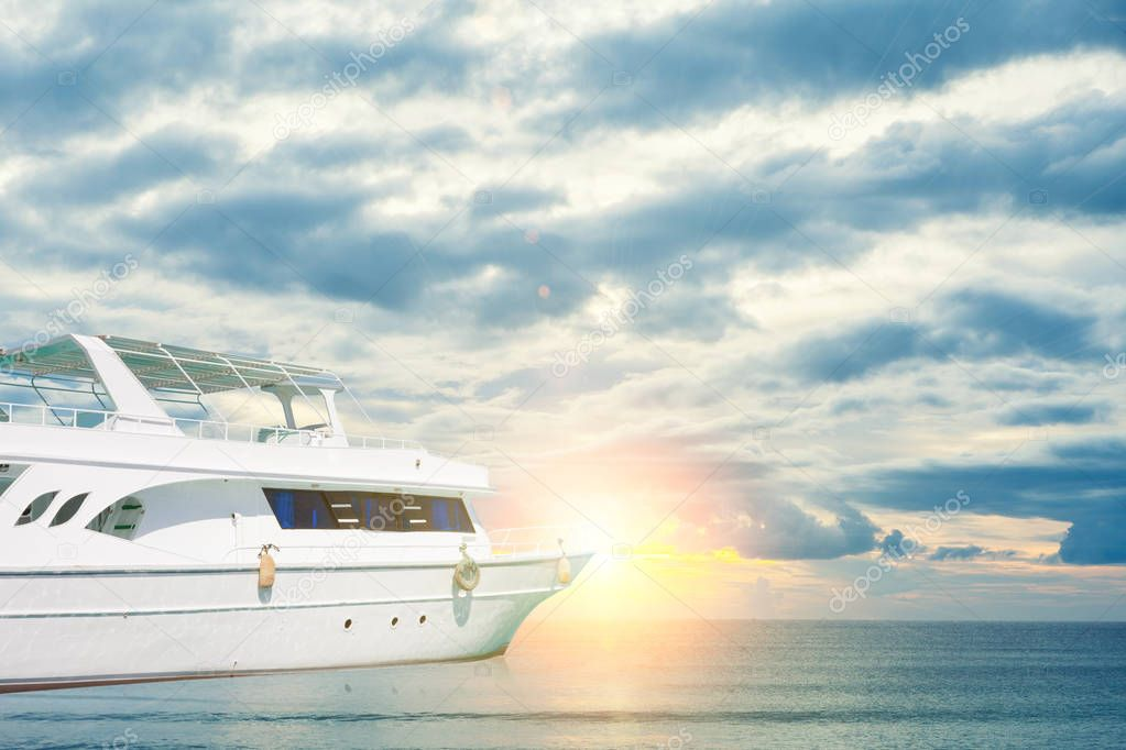 white yatch in beautiful sea at sunset