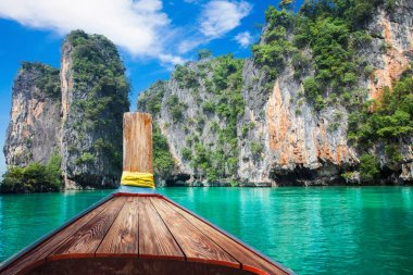 Boat trip to tropical islands from Phuket, Krabi in Thailand. Green mountains and blue water lagoon