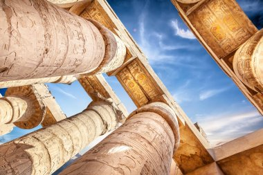 Great Hypostyle Hall and clouds at Temples of Karnak, ancient Thebes. Luxor, Egypt
