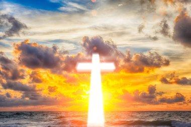 Glowing cross on beautiful sky background