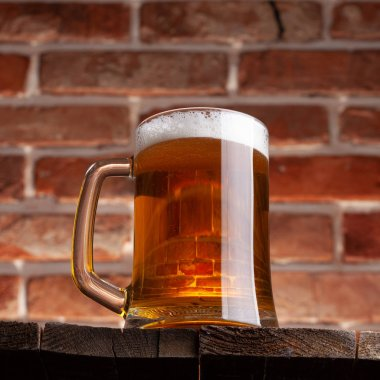 Mug of a beer on the red brick wall background