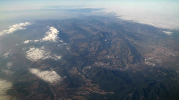 Alps from air view. Photo from plane. Aerial view of alpine mountains. Aerial view of amazing landscapes, hills, mountains and shapes. Beautiful natural backdrop.