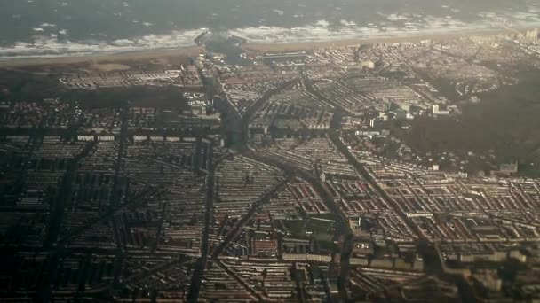 Netherland from air view. Photo from plane. Aerial view of Holland. Aerial view of amazing landscapes, sea, meadows and shapes. Beautiful natural backdrop.