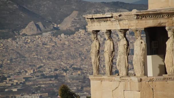 Acropolis of Athens, Greece, with the Parthenon Temple. Famous old Parthenon temple is the main landmark of Athens. View of Odeon of Herodes Atticus, Figures of the Caryatid Porch of the Erechtheion.