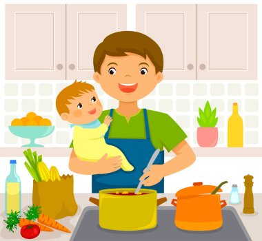 Young man holding a baby while cooking in the kitchen