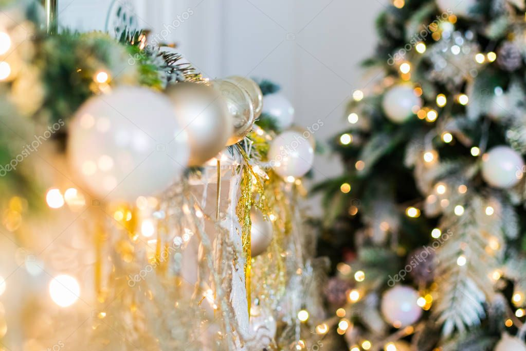the new year is 2019. Christmas tree decorated with toys balls glitters. the background bokeh backdrop